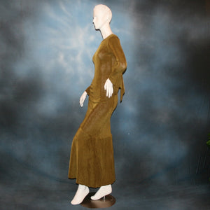left side view of Sage green Latin/rhythm/social dress created of luxurious sage green slinky features ruching up the right side & long sleeves with an open flared detail.