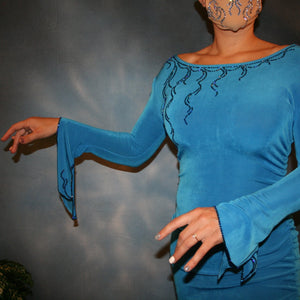 Crystal's Creations close up view of blue slinky Latin/rhythm dress with detailed blue Swarovski rhinestone work