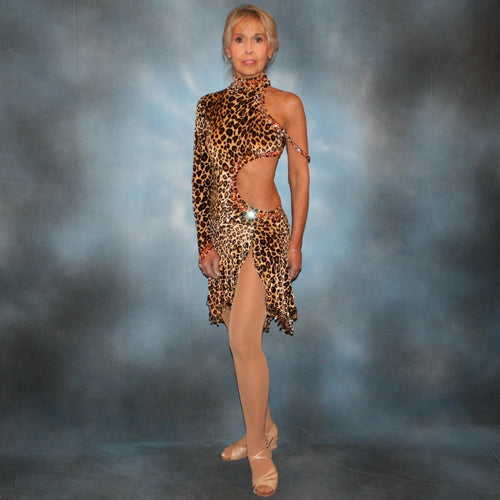 Cheetah print stretch velvet Latin/rhythm dance dress is embellished with about 10 gross of Topaz Ab Swarovski rhinestones & hand beading at skirt bottom & arm band.