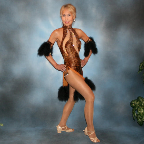 Latin/Rhythm dance dress created of leopard print stretch velvet has nude illusion cutouts through bodice, is enhanced with Aurora Austrian Swarovski rhinestones, has hand beading of black faceted beads, aurora teardrop beads and marabou feathers.