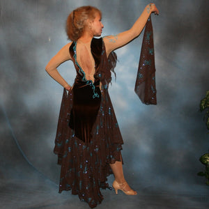 Crystal's Creations back view of Exquisite brown ballroom dance dress with turquoise accents was created in luxurious chocolate brown stretch velvet on a nude illusion base…featuring billowing yards of brown chiffon petal panels with glittery turquoise butterflies.
