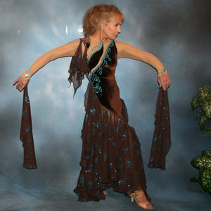 Exquisite brown ballroom dance dress with turquoise accents was created in luxurious chocolate brown stretch velvet on a nude illusion base…featuring billowing yards of brown chiffon petal panels with glittery turquoise butterflies.