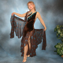 Load image into Gallery viewer, Crystal's Creations Exquisite brown ballroom dance dress with turquoise accents was created in luxurious chocolate brown stretch velvet on a nude illusion base…featuring billowing yards of brown chiffon petal panels with glittery turquoise butterflies.