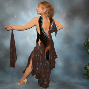 Crystal's Creations side back view of Exquisite brown ballroom dance dress with turquoise accents was created in luxurious chocolate brown stretch velvet on a nude illusion base…featuring billowing yards of brown chiffon petal panels with glittery turquoise butterflies.