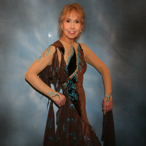 Crystal's Creations close up view of Exquisite brown ballroom dance dress with turquoise accents was created in luxurious chocolate brown stretch velvet on a nude illusion base…featuring billowing yards of brown chiffon petal panels with glittery turquoise butterflies.