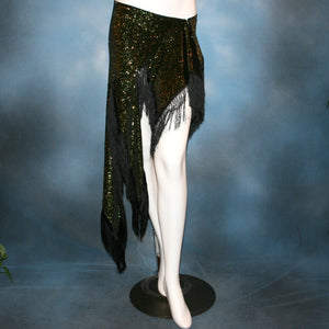 Crystal's Creations Green Latin/skirt skirt, wrap style, was created with luxurious green glitter slinky & chainette fringe. There is just enough of the gorgeous fabric to custom create a bodysuit to go with it for an extra fee, possibly two...one on the simple classy side for ballroom social dances & the other could be more elaborate with Swarovski work for ballroom showcases or competitions, making it a converta ballroom dance set!
