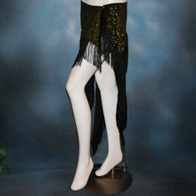 Load image into Gallery viewer, left side view of Green Latin/skirt skirt, wrap style, was created with luxurious green glitter slinky & chainette fringe. There is just enough of the gorgeous fabric to custom create a bodysuit to go with it for an extra fee, possibly two...one on the simple classy side for ballroom social dances & the other could be more elaborate with Swarovski work for ballroom showcases or competitions, making it a converta ballroom dance set!