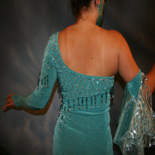 Load image into Gallery viewer, Crystal's Creations close up back view of Aqua Latin/rhythm dress created in luxurious aqua solid slinky, with flounces of aqua glittered organza, embellished with aqua Ab Swarovski rhinestones. I recently added a 2nd set of flounces in a gorgeous glitter swirly lace, Swarovski hand beading plus an arm embellishment.