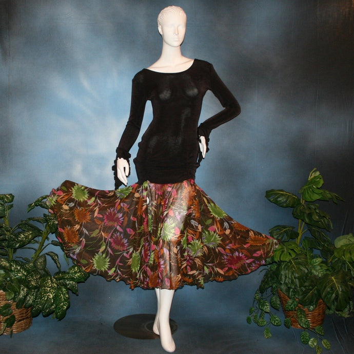 Crystal's Creations Deep chocolate brown social ballroom dress created of luxurious deep chocolate brown solid slinky base featuring ruching through the hip area, & interesting long flared sleeves, with yards of fall colored flowers chiffon petal panels