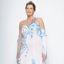 Load image into Gallery viewer, close upper view of White ballroom dress with blue accents was created on nude illusion of a soft white knit with flounce accents of sky blue & white floral print satin, embellished with sapphire Swarovski stonework & miniature white silk roses.