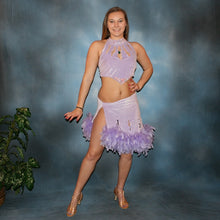 Load image into Gallery viewer, Crystal's Creations Sassy orchid little two piece Latin/rhythm dress of orchid luxurious glitter stretch velvet with chandelle feathers at skirt edge & CAB Swarovski stones accenting peak of bodice & fully covering neck band