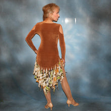 Load image into Gallery viewer, Crystal's Creations back view of Latin/rhythm dance dress of luxurious cinnamon/ginger colored solid slinky with flounces of tropical/leopard print, enhanced with hand beading through out the flounces is a converta-ballroom dress