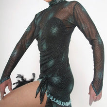Load image into Gallery viewer, close side view of Elegant black Latin/rhythm dance dress was created in a black glitter sheer mesh with aqua glitter bursts over black lycra body suit, embellished with jet AB Swarovski stones, hand beading, plus chandelle feathers.