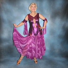 Load image into Gallery viewer, Crystal's Creations Purple/plum ballroom dress created of rich & luxurious plum metallic slinky ballroom dance dress with yards & yards of print chiffon… embellished with fuchsia Swarovski rhinestones… along with hand beading of bicone & teardrop Swarovski beads