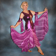 Load image into Gallery viewer, Crystal's Creations right side view of Purple/plum ballroom dress created of rich & luxurious plum metallic slinky ballroom dance dress with yards & yards of print chiffon… embellished with fuchsia Swarovski rhinestones… along with hand beading of bicone & teardrop Swarovski beads