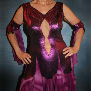 Crystal's Creations close up view of Purple/plum ballroom dress created of rich & luxurious plum metallic slinky ballroom dance dress with yards & yards of print chiffon… embellished with fuchsia Swarovski rhinestones… along with hand beading of bicone & teardrop Swarovski beads