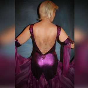 Crystal's Creations close up back view of Purple/plum ballroom dress created of rich & luxurious plum metallic slinky ballroom dance dress with yards & yards of print chiffon… embellished with fuchsia Swarovski rhinestones… along with hand beading of bicone & teardrop Swarovski beads