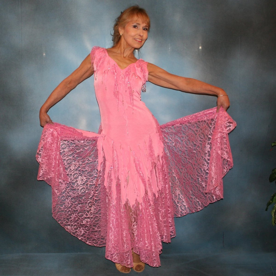 Crystal's Creations Soft pink converta ballroom dress consisting of a Latin/rhythm dress created in luxurious solid slinky with detailing of slinky & lace petals that are individually made & sewn on, embellished with hand beading of light rose Swarovski beads of various shapes throughout the petals.