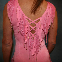 Load image into Gallery viewer, Crystal's Creations close up back view of details of Soft pink converta ballroom dress consisting of a Latin/rhythm dress created in luxurious solid slinky with detailing of slinky & lace petals that are individually made & sewn on, embellished with hand beading of light rose Swarovski beads of various shapes throughout the petals.