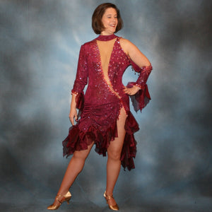 Crystal's Creations Burgundy Latin/rhythm dress created of burgundy glitter slinky with flounces of burgundy organza, embellished with light rose Ab Swarovski rhinestone work along with light rose extensive Swarovski hand beading