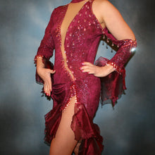 Load image into Gallery viewer, Crystal's Creations side view of Burgundy Latin/rhythm dress created of burgundy glitter slinky with flounces of burgundy organza, embellished with light rose Ab Swarovski rhinestone work along with light rose extensive Swarovski hand beading