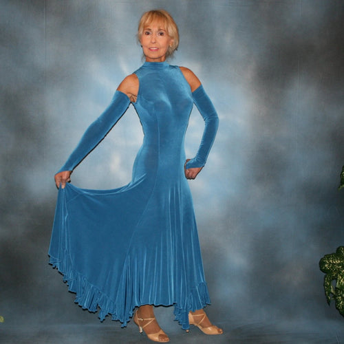 Ballroom dance dress created in luxurious medium blue solid slinky features flouncing at the bottom sides, includes gauntlets, plus can be worn with a bra… or a custom under body suit can be made to go with it, for an extra fee,plus is fabulous for beginner ballroom dancers.