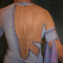 Load image into Gallery viewer, Crystal's Creations back view close up of Blue ballroom dress created in periwinkle blue luxurious glitter slinky on nude illusion base with tricot chiffon flounces in shades of perwinkle & soft pink