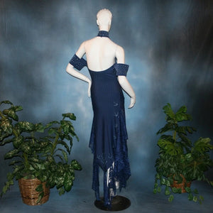 back view of Navy blue tango dress or Latin/rhythm dress created in rib textured lycra, with flounces of barcelona lace, adorned with light sapphire Swarovski rhinestones & larger navy lucite gems.