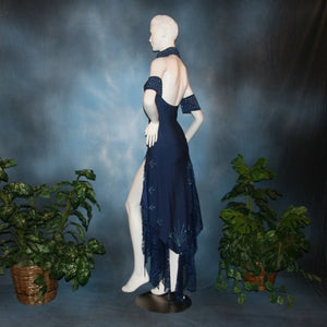 side view of Navy blue tango dress or Latin/rhythm dress created in rib textured lycra, with flounces of barcelona lace, adorned with light sapphire Swarovski rhinestones & larger navy lucite gems.