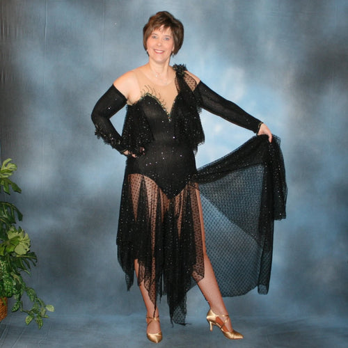 Black tango dress created in slinky glitterknit with glitter lace flounces & skirting. Jet Ab Swarovski rhinestones embellish the nude illusion chest as well as peak of sleeves…with a finishing touch of silk black iridescent roses & orchids that have a hint of green.