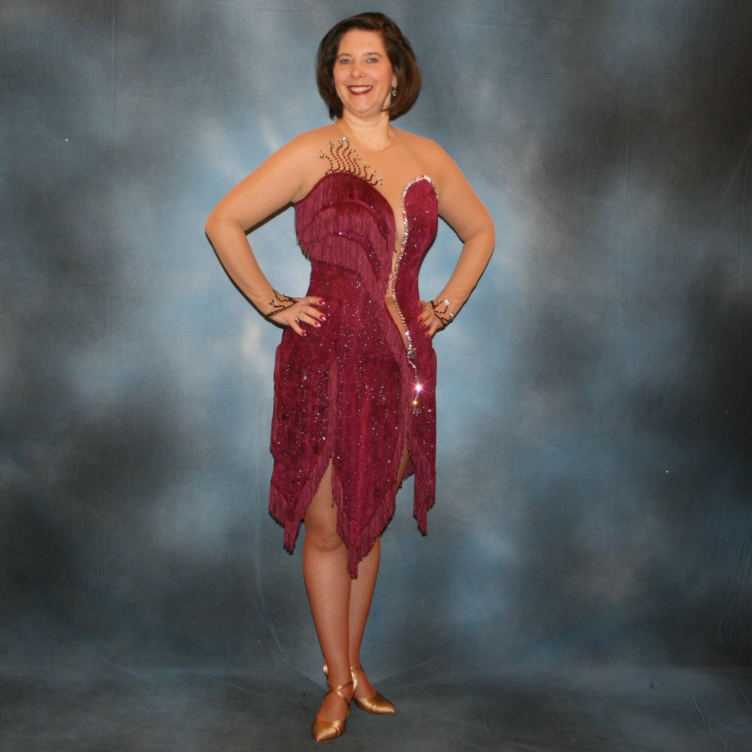 Burgundy Latin/rhythm dress created of burgundy glitter slinky with subtle reptilia print on a nude illusion base with chainette fringe, embellished with crystal & burgundy Swarovski rhinestone work on sale!