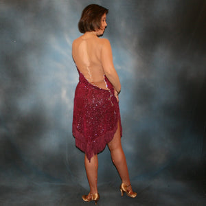 back view of Burgundy Latin/rhythm dress created of burgundy glitter slinky with subtle reptilia print on a nude illusion base with chainette fringe, embellished with crystal & burgundy Swarovski rhinestone work on sale