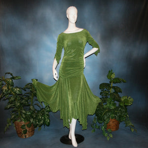 Ruched top with ruched 3/4 sleeves with a slight flaired detail includes trumpet flaired ballroom dance skirt with peaks created of luxurious olive green solid slinky fabric, & can be custom created in many colors.