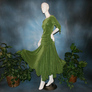 side view of Ruched top with ruched 3/4 sleeves with a slight flaired detail includes trumpet flaired ballroom dance skirt with peaks created of luxurious olive green solid slinky fabric, & can be custom created in many colors. Great for ballroom dance teachers!