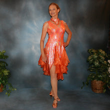 Load image into Gallery viewer, Crystal's Creations Orange Latin/rhythm dress was created in orange & silver metallic print lycra with oodles of glitter organza flounces & accents, has back strap detailing, embellished with extensive Swarovski hand beading & has matching Swarovski hand beaded neckpiece.