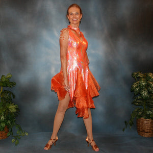 Crystal's Creations Orange Latin/rhythm dress was created in orange & silver metallic print lycra with oodles of glitter organza flounces & accents, has back strap detailing, embellished with extensive Swarovski hand beading & has matching Swarovski hand beaded neckpiece.