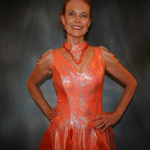 Crystal's Creations close up view of Orange Latin/rhythm dress was created in orange & silver metallic print lycra with oodles of glitter organza flounces & accents, has back strap detailing, embellished with extensive Swarovski hand beading & has matching Swarovski hand beaded neckpiece.