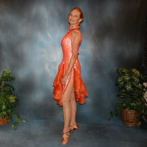 Crystal's Creations side view of orange Latin dress created in orange & silver metallic lycra with orange glitter organza flounces