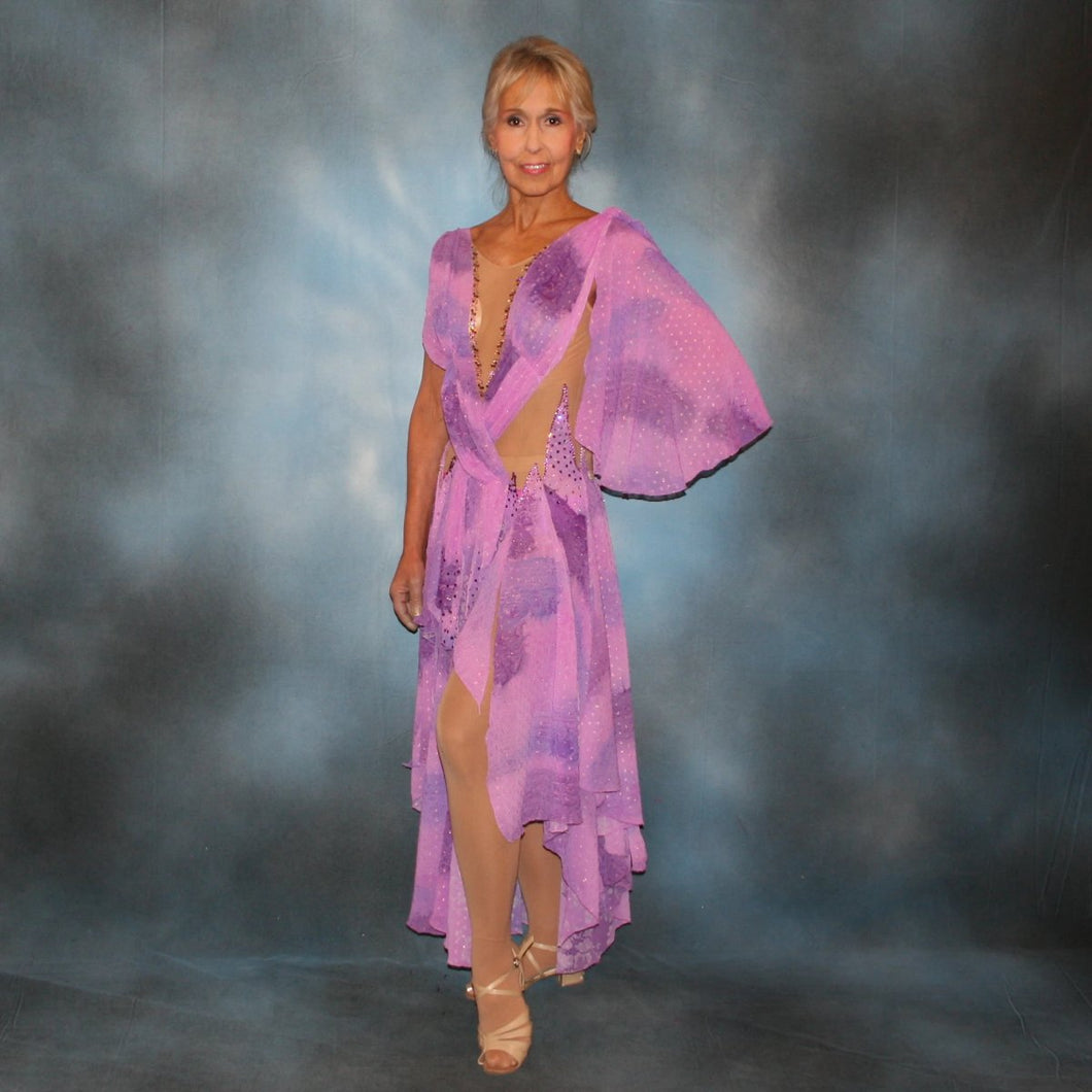 Crystal's Creations Orchid ballroom dress created in yards of a textured chiffon in shades of orchids & purples on a nude illusion base with floats & Swarovski stonework in gorgeous shades of orchids & purples.