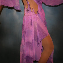 Load image into Gallery viewer, Crystal's Creations close up side view of Orchid ballroom dress created in yards of a textured chiffon in shades of orchids & purples on a nude illusion base with floats & Swarovski stonework in gorgeous shades of orchids & purples.