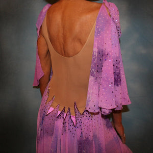 Crystal's Creations close up of backview of Orchid ballroom dress created in yards of a textured chiffon in shades of orchids & purples on a nude illusion base with floats & Swarovski stonework in gorgeous shades of orchids & purples.