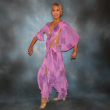 Load image into Gallery viewer, Crystal's Creations side view of Orchid ballroom dress created in yards of a textured chiffon in shades of orchids & purples on a nude illusion base with floats & Swarovski stonework in gorgeous shades of orchids & purples.