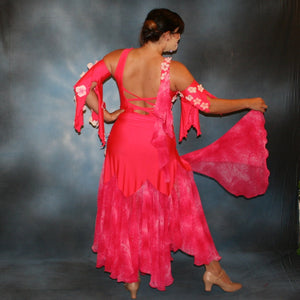 Crystal's Creations back view of  deep pink ballroom dress created of Indian pink lycra base with yards & yards of Indian pink print chiffon large & flowing flounces, embellishing done with silk flowers, accented with Swarovski stonework in Indian pink .