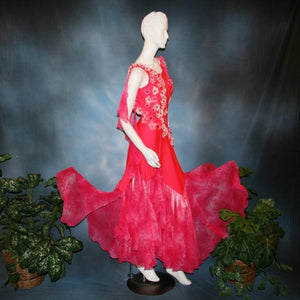 Crystal's Creations side view of Deep pink ballroom dress created of Indian pink lycra base with yards & yards of Indian pink print chiffon large & flowing flounces, embellishing done with silk flowers, accented with Swarovski stonework in Indian pink .