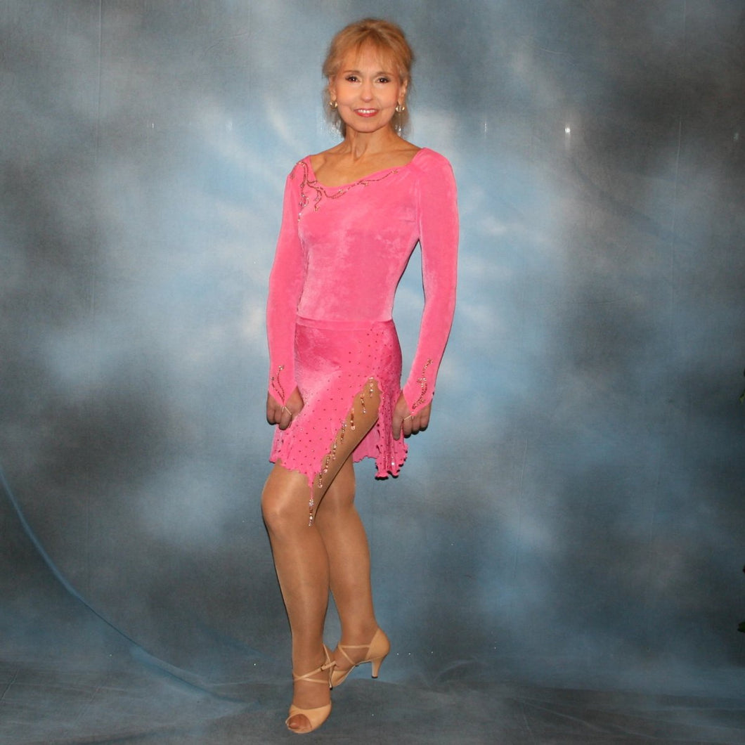 Crystal's Creations Pink converta dance dress of deep bubble gum pink luxurious solid slinky long sleeve body suit embellished with gold aurum Swarovski rhinestone work, with 2 Latin skirts!