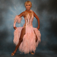 Load image into Gallery viewer, Crystal's Creations soft pink ballroom dress with ostrich feathers was created of soft pink lycra overlaid on a nude illusion base, embellished with light peach Swraovski rhinestone work, large teardrop shaped gems along with some drape beading.