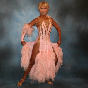 Crystal's Creations soft pink ballroom dress with ostrich feathers was created of soft pink lycra overlaid on a nude illusion base, embellished with light peach Swraovski rhinestone work, large teardrop shaped gems along with some drape beading.