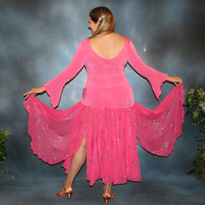 Crystal's Creations back view of Bubble gum pink solid slinky body suit with long flaired sleeves includes 3 ballroom skirts, one for smooth with yards of glitter chiffon, a 2nd, with oodles of print chiffon flounces, which is great for rumba, bolero or tango & a 3rd of solid slinky to wear for Latin/rhythm dancing