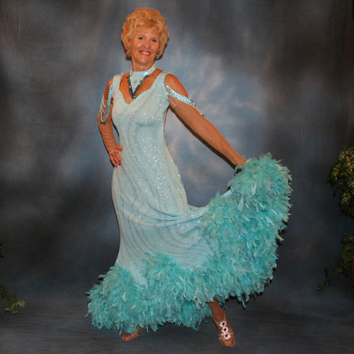 Soft blue ballroom dress with chandelle feathers was created of a gorgeous glitter slinky with a wave pattern, has strap detailing on the low back, embellished with Swarovski rhinestones & hand beading on the arm draping straps & matching neck piece.