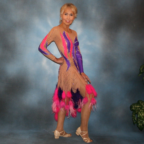 Crystal's Creations Purple & hot pink Latin/rhythm dress created of detailed artwork of purple & hot pink lycra on a nude illusion base, embellished with purple, fuchsia Swarovski rhinestone work, along with marabou feathers & hand beading.
